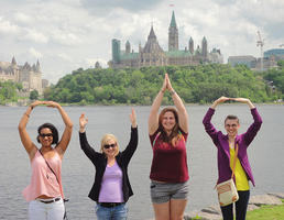 Four students pose the O-H-I-O in Montreal.