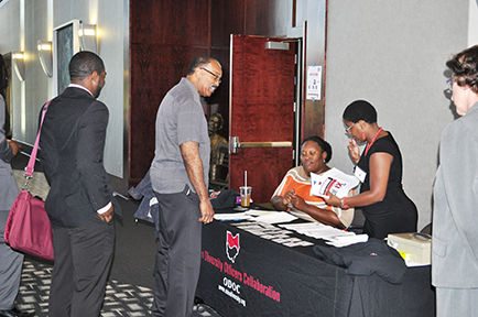 Attendees check in at the conference.