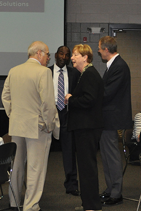 Dr. Bonnie L. Coe, Ph.D., President of COTC and Dr. William MacDonald, (r) Dean/Director of Ohio State Newark speak with Martin Belsky, J.D., and Lee Gill, J.D., ODOC President.