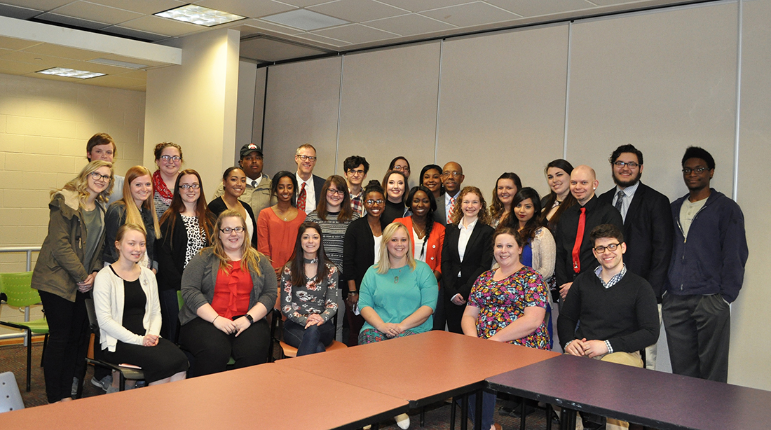 Students pose with The Ohio State University President Dr. Drake